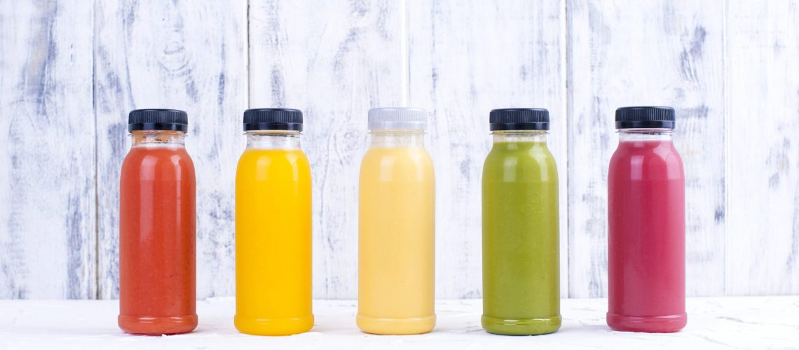Organic cold-pressed raw vegetable juices in glass bottles. Vitamin and healthy food. Copy space.,