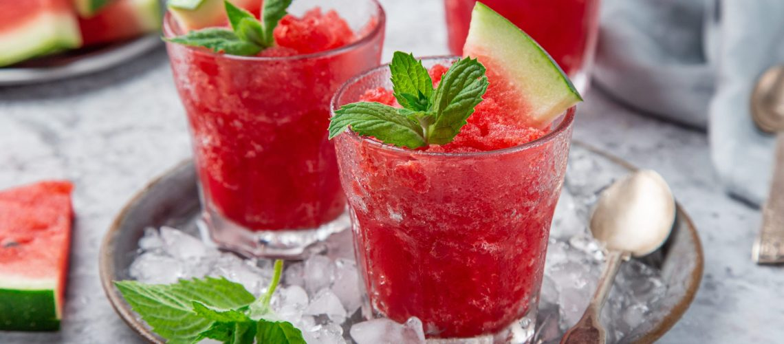watermelon granita or sorbet with mint and fresh watermelon slices in glass, selective focus
